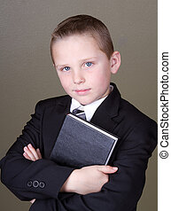 Boy holding book