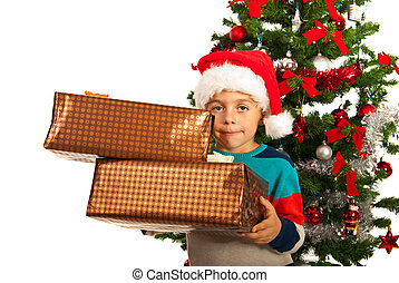 Boy holding Christmas gifts
