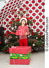 Boy holding Christmas present