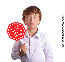 Boy holding christmas sign asking Santa to come by. Isolated on white background