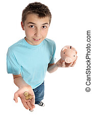 Boy holding coins for money box
