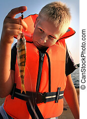 boy holding his catch of the day