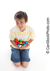 Boy holding lots of easter eggs