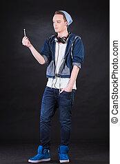 Boy holding marijuana joint