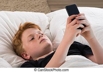 Boy Holding Mobile Phone