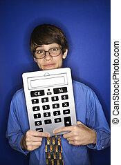 Boy holding oversized calculator. - Portrait of Caucasian...