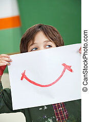 Boy Holding Paper With Smile Drawn On It