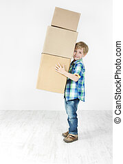 Boy holding pyramid of carton boxes. Packing up to move. Growth concept.