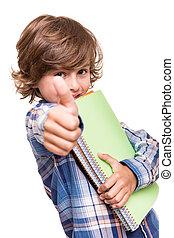 Boy holding school books