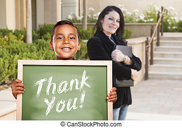 Boy Holding Thank You Chalk Board with Teacher Behind