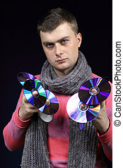 boy holds disks in both hands