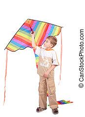 boy holds kite