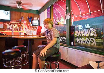 boy in a bar