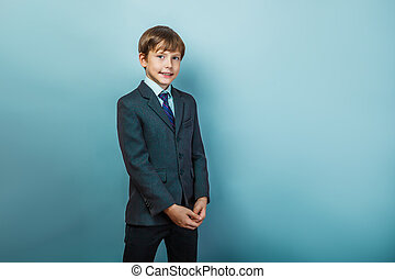 Boy in a business  suit  smiling