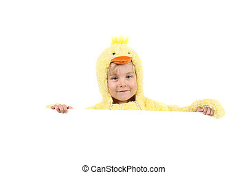 Boy in a chicken costume holding a sign