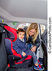 boy in a child seat