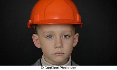 Boy in a construction helmet.Full hd video