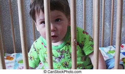 Boy in a crib