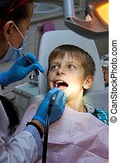 boy in a dental surgery - Young boy in a dental surgery