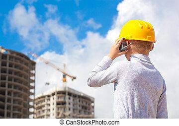 Boy in a helmet looking at building