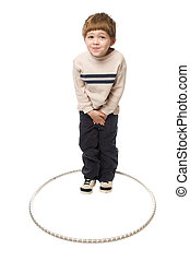 boy in a hoop - young boy standing and acting silly on a...