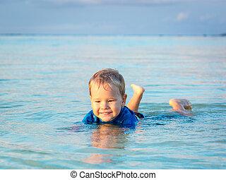 Boy in a sea