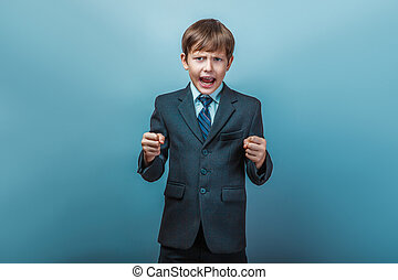 boy in a suit shouting