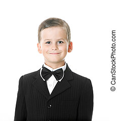 Boy in a suit smiles
