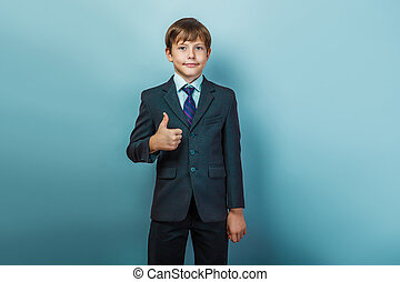 boy in a suit   thumbs up