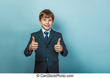 Boy in a suit with thumbs up