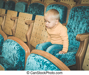 Boy in a theatre