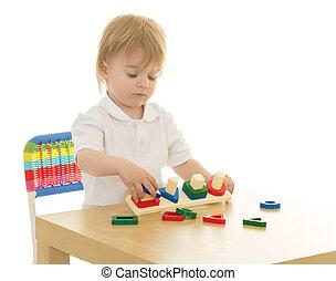 Boy in a Waldorf kindergarten - Cute little blonde boy...