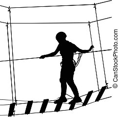 boy in adventure park rope ladder. Silhouette Adventure. Extreme sportsman took down with rope. Sport weekend action in adventure park rope ladder.