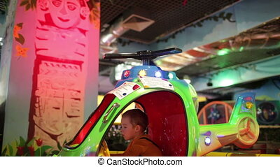 Boy in amusement helicopter