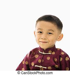 Boy in Asian costume.