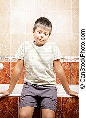 Boy in bathroom