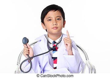 boy in big spectacles playing doctor with stethoscope