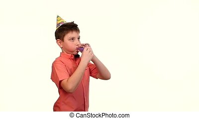 boy in birthday cap inflates a purple ball white background....