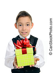 boy in black suit holding green gift box isolated