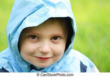 Boy in blue hood