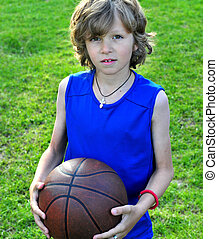 Boy in blue shirt with a basketball