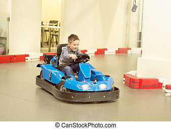 Boy in bumper car driving autoscooter