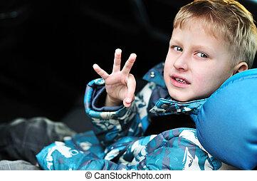 boy in car-seat