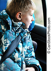 boy in carseat looking in the window