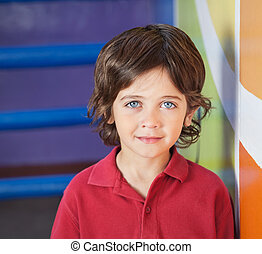 Boy In Casuals Smiling In Preschool