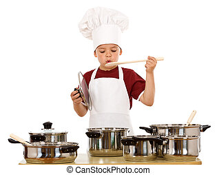 Boy in chef hat playing