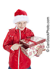 boy in christmas hat holding present over whit