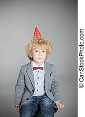 Boy in cone hat