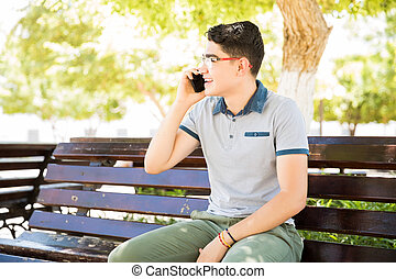Boy in conversation with friend on phone