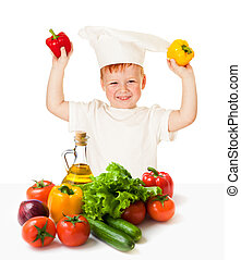 boy in cooking hat with vegetables isolated